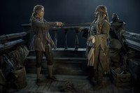 """""""PIRATES OF THE CARIBBEAN: DEAD MEN TELL NO TALES""""..The villainous Captain Salazar (Javier Bardem) pursues Jack Sparrow (Johnny Depp) as he searches for the trident used by Poseidon..Pictured L-R: Brenton Thwaites (Henry) and Johnny Depp (Captain Jack Sparrow)..Ph: Peter Mountain..© Disney Enterprises, Inc. All Rights Reserved."""