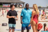 (L-R) Jon Bass as Ronnie, Hannibal Buress as Dave, and Kelly Rohrbach as CJ Parker in the film BAYWATCH by Paramount Pictures, Montecito Picture Company, FlynnPicture Co., and Fremantle Productions